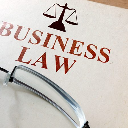 Code of  business law on a wooden table.